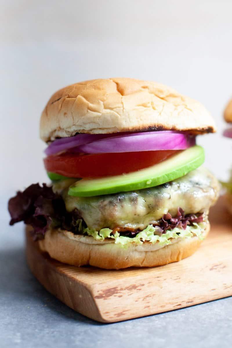 Close-up shot of a Garden Onion Burger on a cutting board