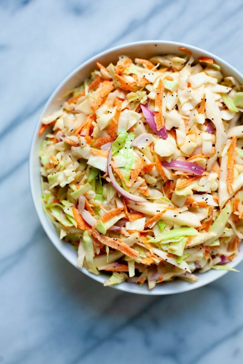 Close-up overhead shot of Sweet and Creamy Coleslaw in a white bowl