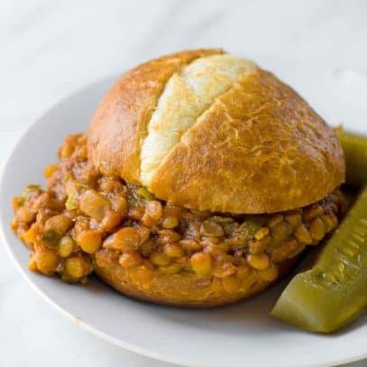 A finished lentil sloppy joe sits on a plate.