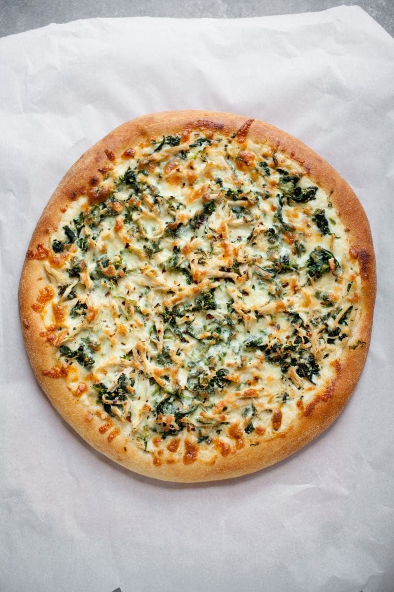 Overhead shot of cooked Chicken Spinach Alfredo Pizza