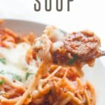 """Slow Cooker Lasagna Soup sits in a bowl. A text overlay reads """"slow cooker lasagna soup"""""""