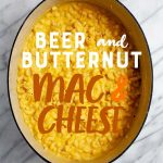 "Beer and Butternut Squash Macaroni and Cheese in a Dutch oven. A text overlay reads ""Beer and Butternut Mac & Cheese."""