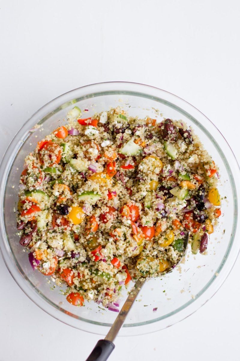 Overhead shot of Greek Quinoa Salad in a glass bowl