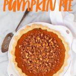 "Lighter Pumpkin Pie with Cinnamon Walnut Streusel in a white pie pan, with a pie server nearby. Text overlay reads ""Lighter Pumpkin Pie."""
