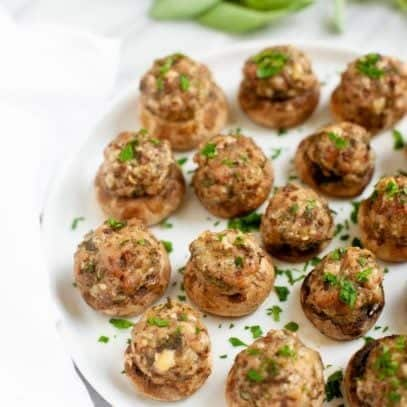 Parmesan and Sausage Stuffed Mushrooms on a white plate