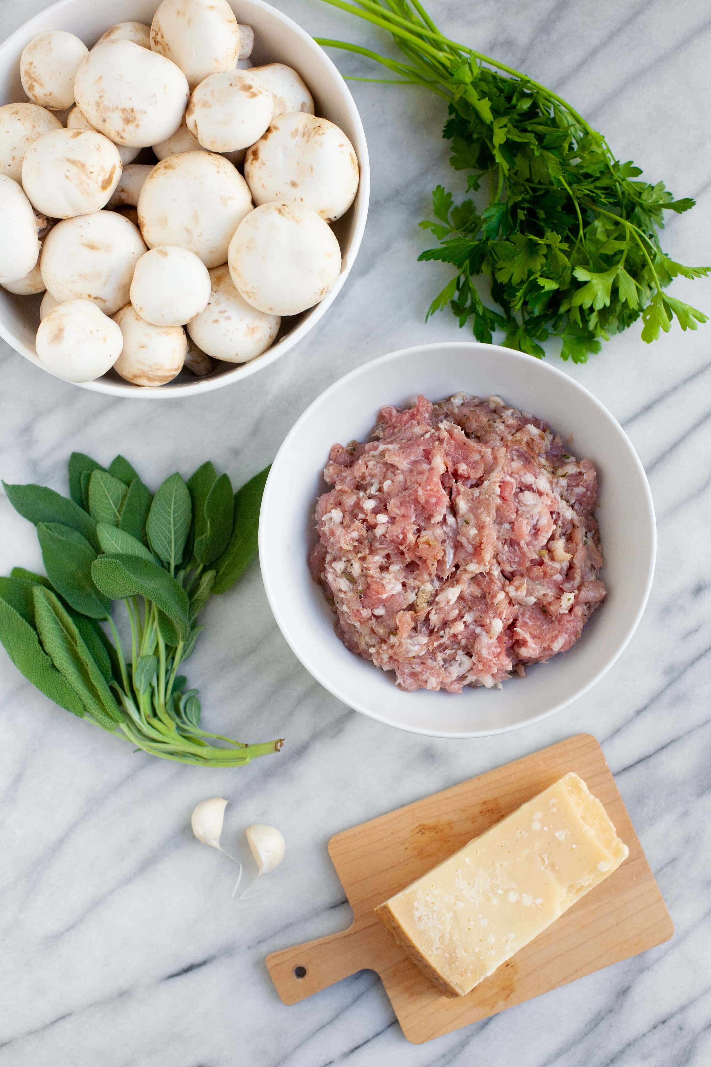 Ingredients for Parmesan and Sausage Stuffed Mushrooms - Parmesan, herbs, sausage, and button mushrooms