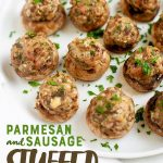 """Parmesan and Sausage Stuffed Mushrooms on a white plate. A text overlay reads """"Parmesan and Sausage Stuffed Mushrooms."""""""
