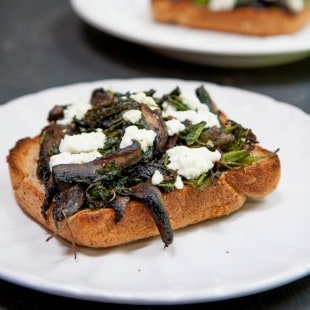 portabella and radish green toasts with goat cheese