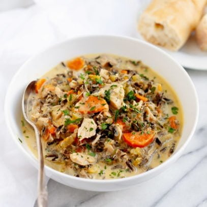 Cream of Turkey and Wild Rice Soup in a white bowl with a spoon