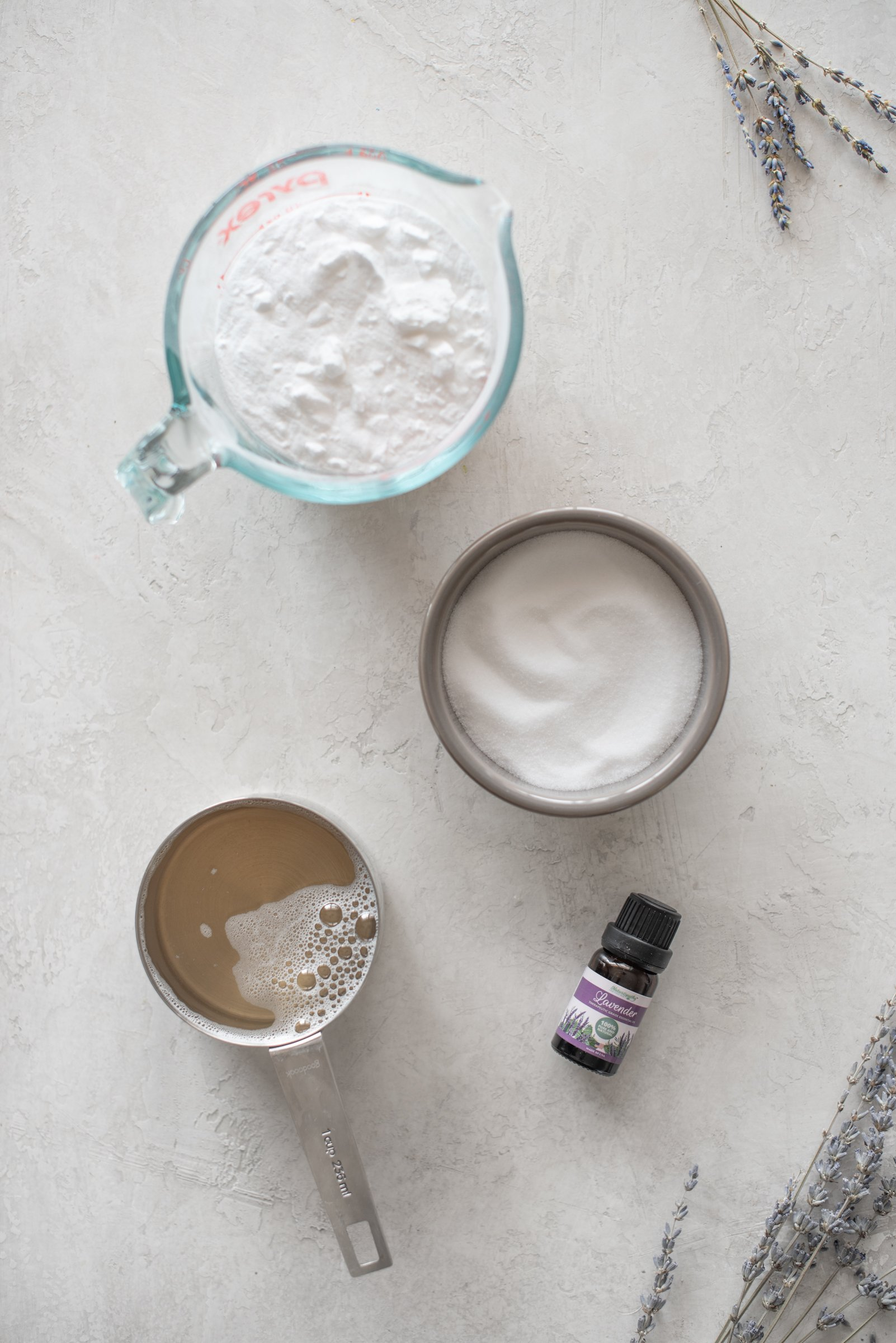 Ingredients for Borax-Free Laundry Detergent in individual measuring cups