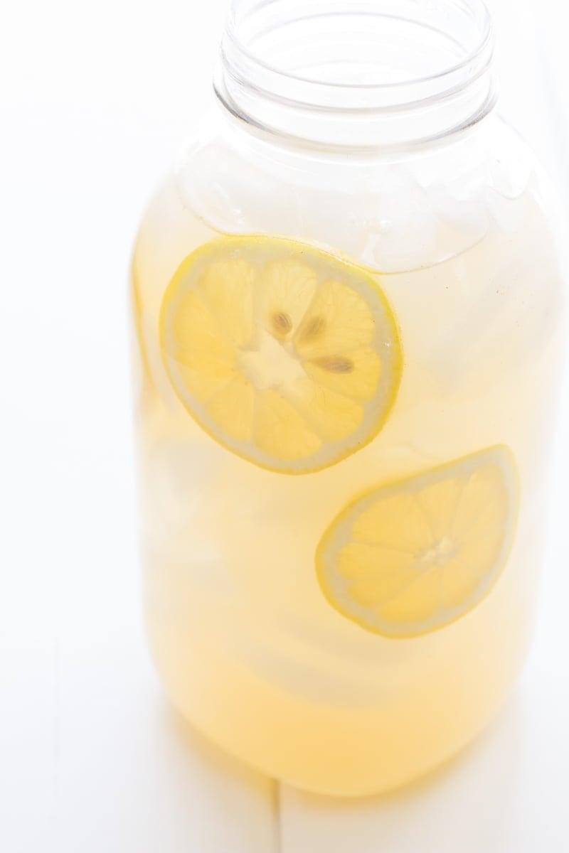 A jar of lemonade sits alone.