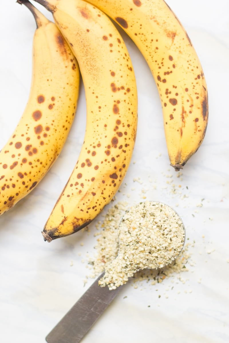 Ingredients to make muffins sit together - bananas and hemp seed