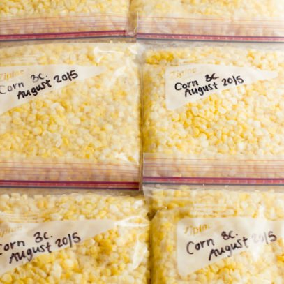 Three rows of zip-top bags filled with fresh corn kernels.