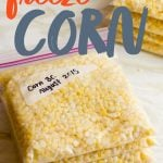 """Stack of zip-top bags filled with corn kernels. A text overlay reads """"How to Freeze Corn."""""""