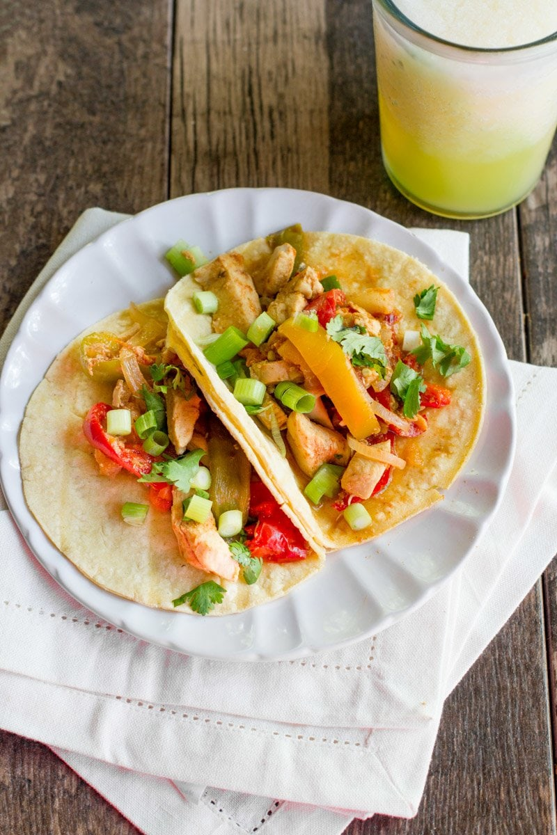 Two Slow Cooker Chicken Fajitas sit together