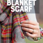 """A red and grey blanket scarf is held with a woman's hand. A text overlay reads """"No-Sew DIY Blanket Scarf."""""""