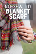"A red and grey blanket scarf is held with a woman's hand. A text overlay reads ""No-Sew DIY Blanket Scarf."""