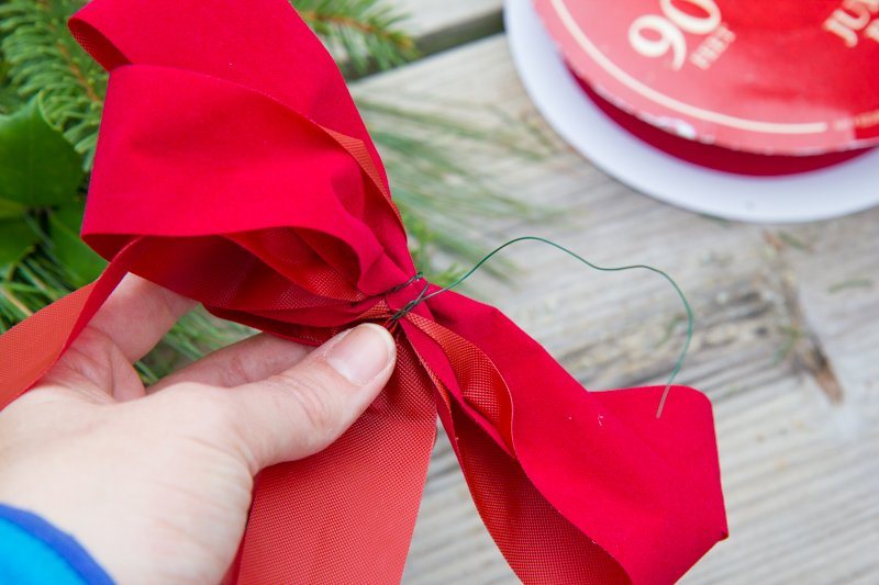 Floral wire wrapped around a red ribbon bow