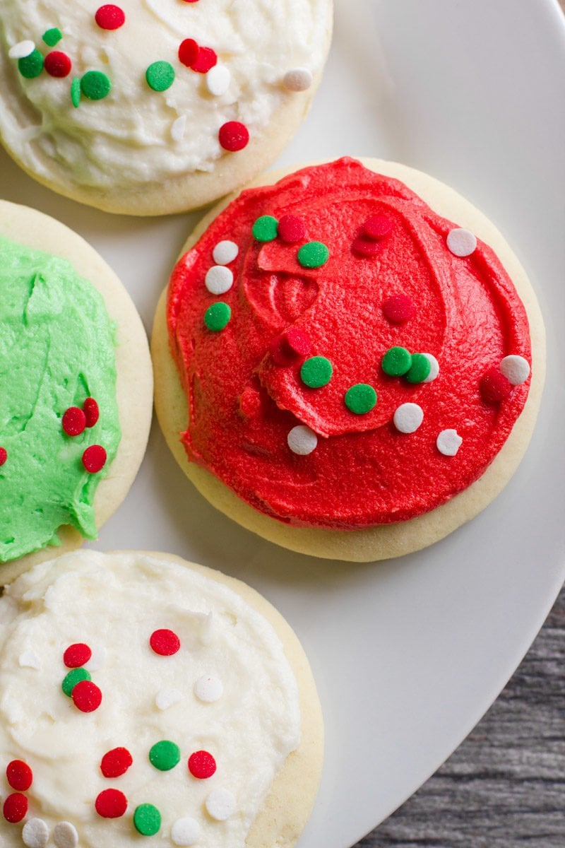 Close-up of Lofthouse Sugar Cookies decorated for Christmas on a white plate