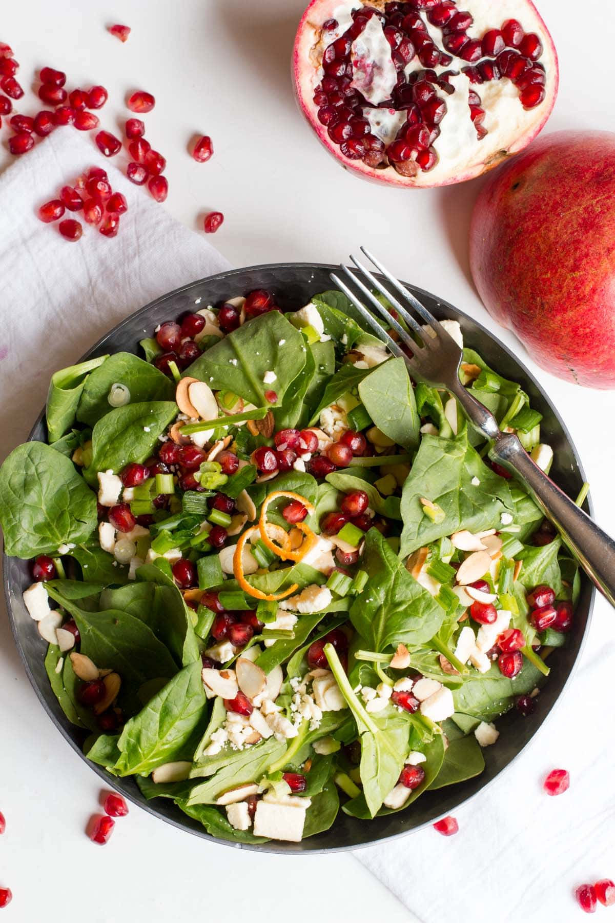 spinach pomegranate salad with clementine vinaigrette