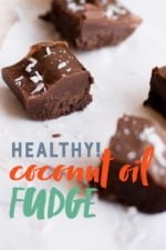 "Squares of Dark Chocolate Coconut Oil Fudge sprinkled with coconut on a white background. A text overlay reads ""Healthy! Coconut Oil Fudge."""