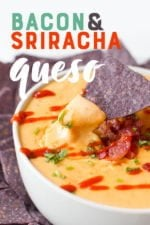 "Blue corn tortilla chip dipping into a white bowl of queso drizzled with sriracha. A text overlay reads ""Bacon & Sriracha Queso."""