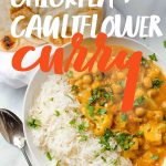 Cauliflower and Chickpea Curry in a white bowl with rice, with a spoon nearby. A text overlay gives the recipe title.
