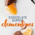 """Two slices of clementine half-covered in chocolate on a white background. A text overlay reads """"Chocolate Dipped Clementines."""""""