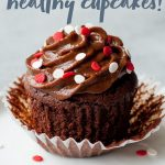 """Chocolate cupcakes with chocolate frosting and red and white sprinkles in a partially unwrapped wrapper. A text overlay reads """"small batch healthy cupcakes!"""""""