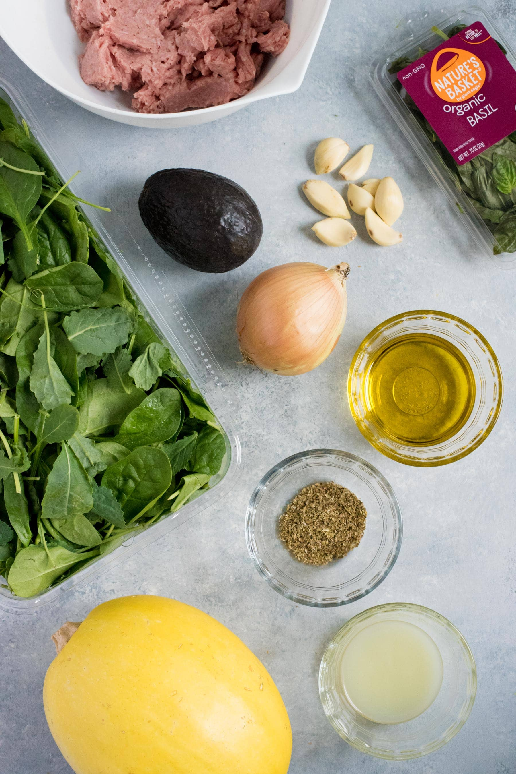 Overhead shot of the ingredients for Turkey Florentine Meatballs with Pesto Spaghetti Squash