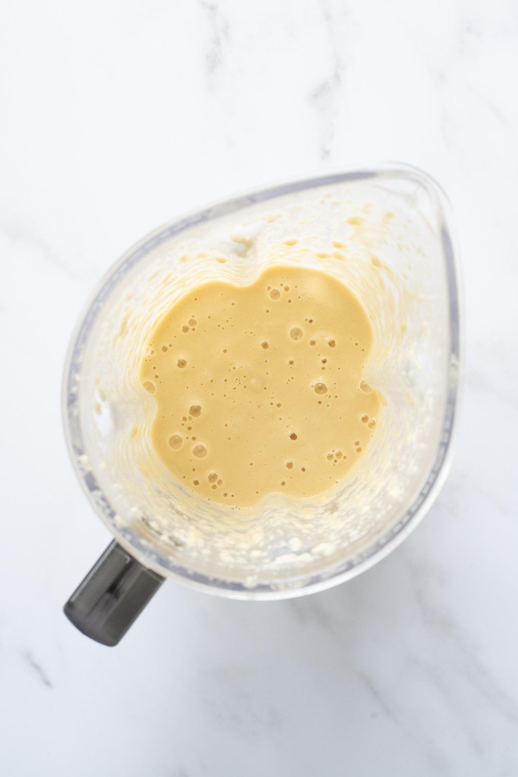 Overhead shot of blender almond pancake batter in a blender carafe