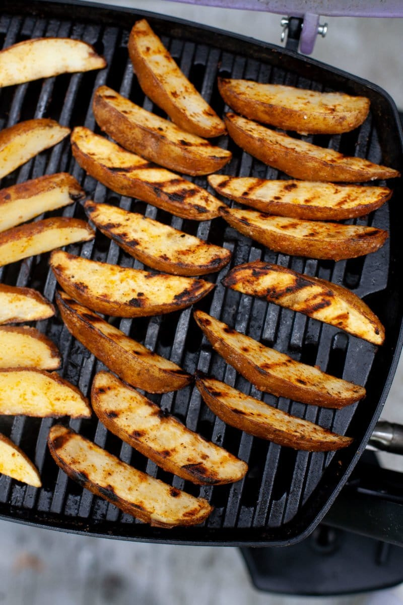 Overhead shot of Perfect Grilled Potato Wedges on a grill