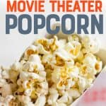 """A hand holds a tub full of popcorn. A text overlay reads """"The Secret to Perfect Movie Theater Popcorn."""""""