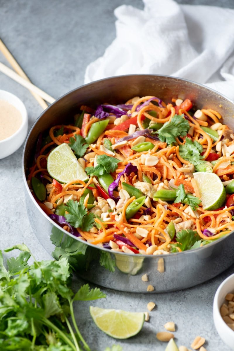 Side angle shot of Meal Prep Chicken Pad Thai with Sweet Potato Noodles in a wide pan