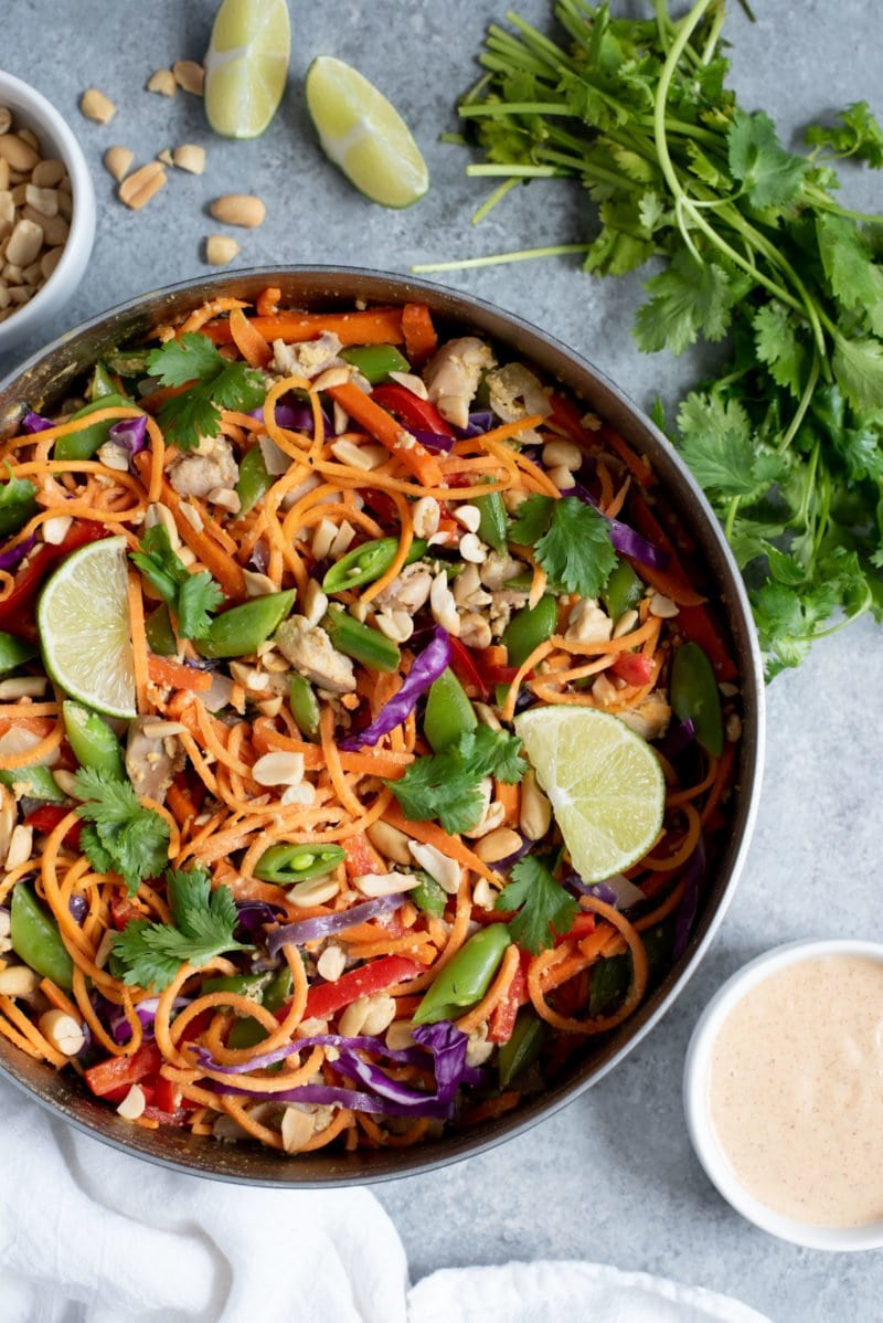 Overhead shot of Meal Prep Chicken Pad Thai with Sweet Potato Noodles in a metal dish