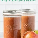 "2 tall glass jars of Instant Pot Applesauce with some apples, with the text ""Perfect Instant Pot Applesauce"""