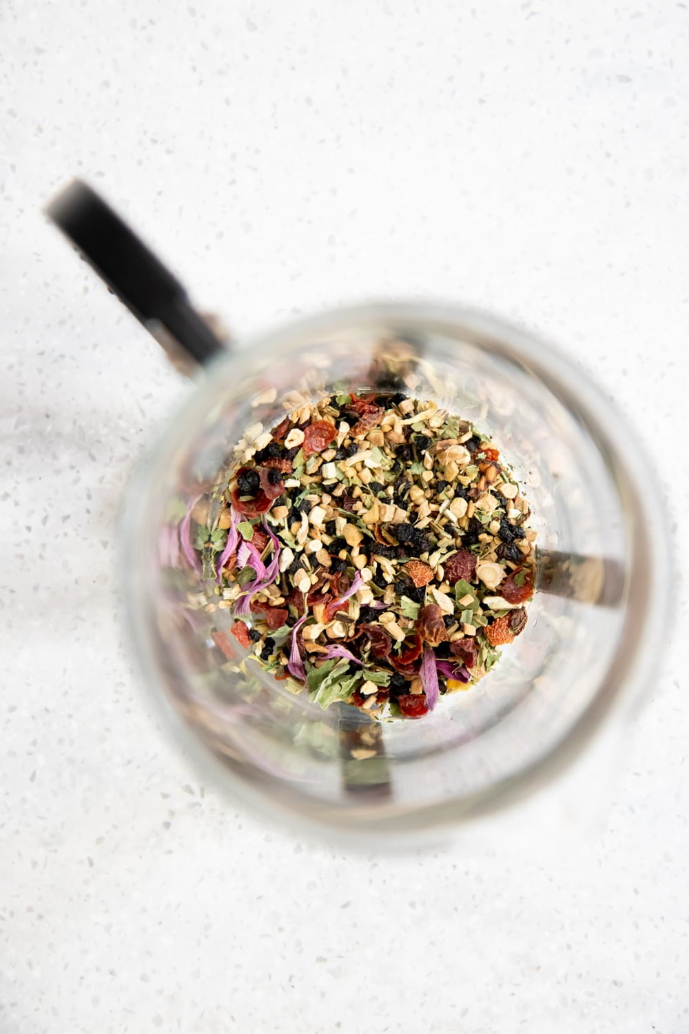 Overhead shot of herbal tea blend in a French press