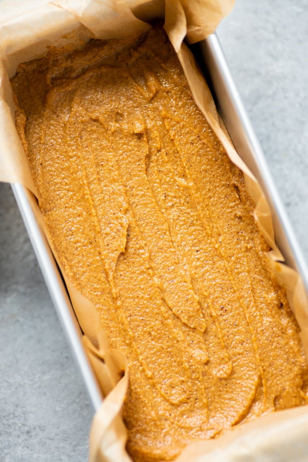Batter for Grain-Free Pumpkin Bread spread into a loaf pan