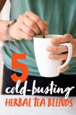 """Hands holding a white mug and a spoon. The person is wearing a green shirt and a bracelet. Text overlay reads """"5 Cold-Busting Herbal Tea Blends"""""""