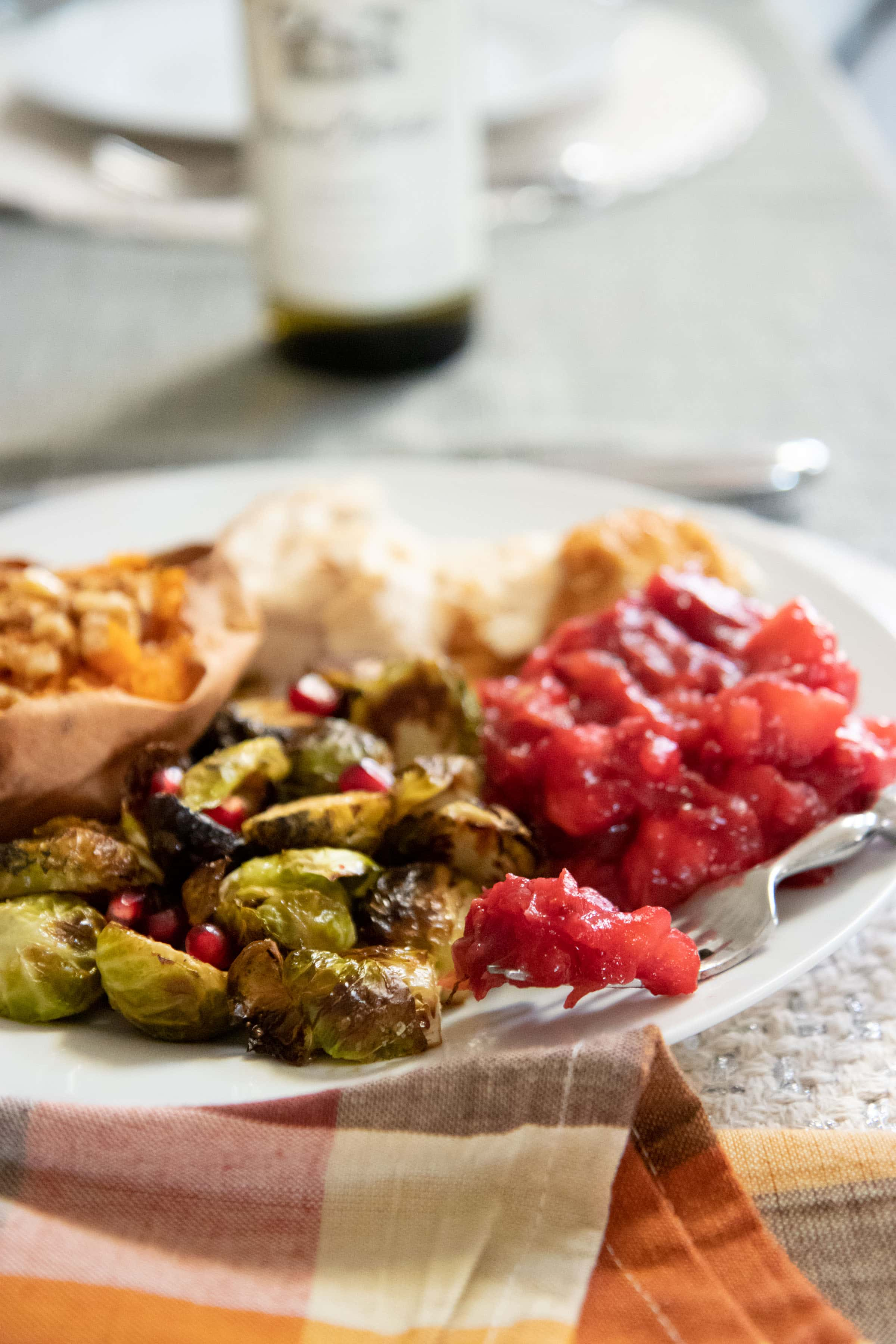 Chunky Cranberry Applesauce and Brussels sprouts on a white plate as part of a Thanksgiving dinner