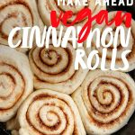 """Unbaked Make-Ahead Vegan Cinnamon Rolls nestled in a cast iron skillet, ready to be baked. A text overlay reads """"Make Ahead Vegan Cinnamon Rolls"""""""