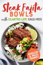 """Steak Fajita Bowls with Cilantro-Lime Cauliflower Rice in a grey bowl on a white background, with toppings in individual bowls nearby. A text overlay reads """"Steak Fajita Bowls with Cilantro-Lime Cauli-Rice. Whole30 and Paleo Friendly."""""""