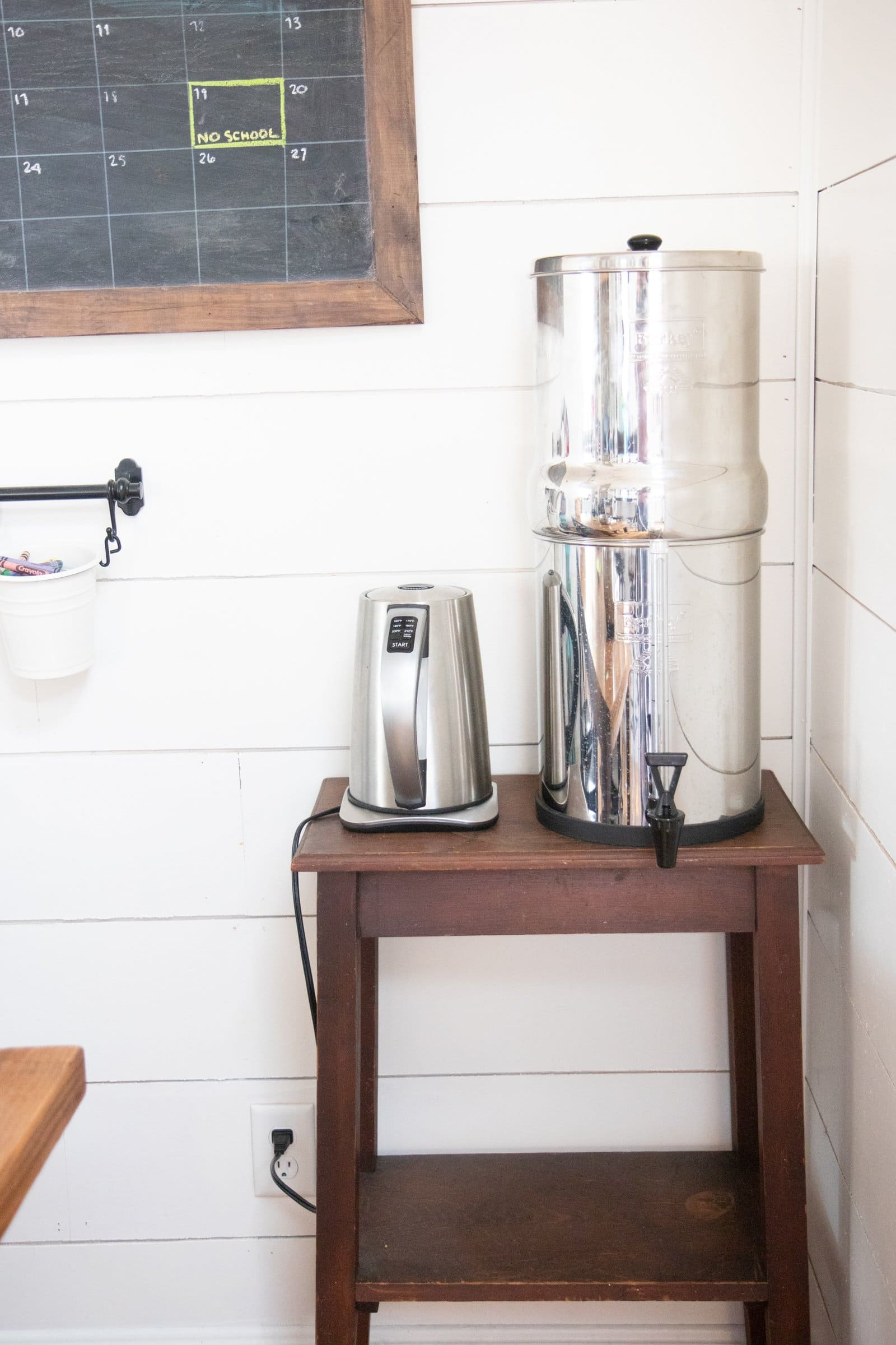 Stainless steel water filter next to an electric tea kettle