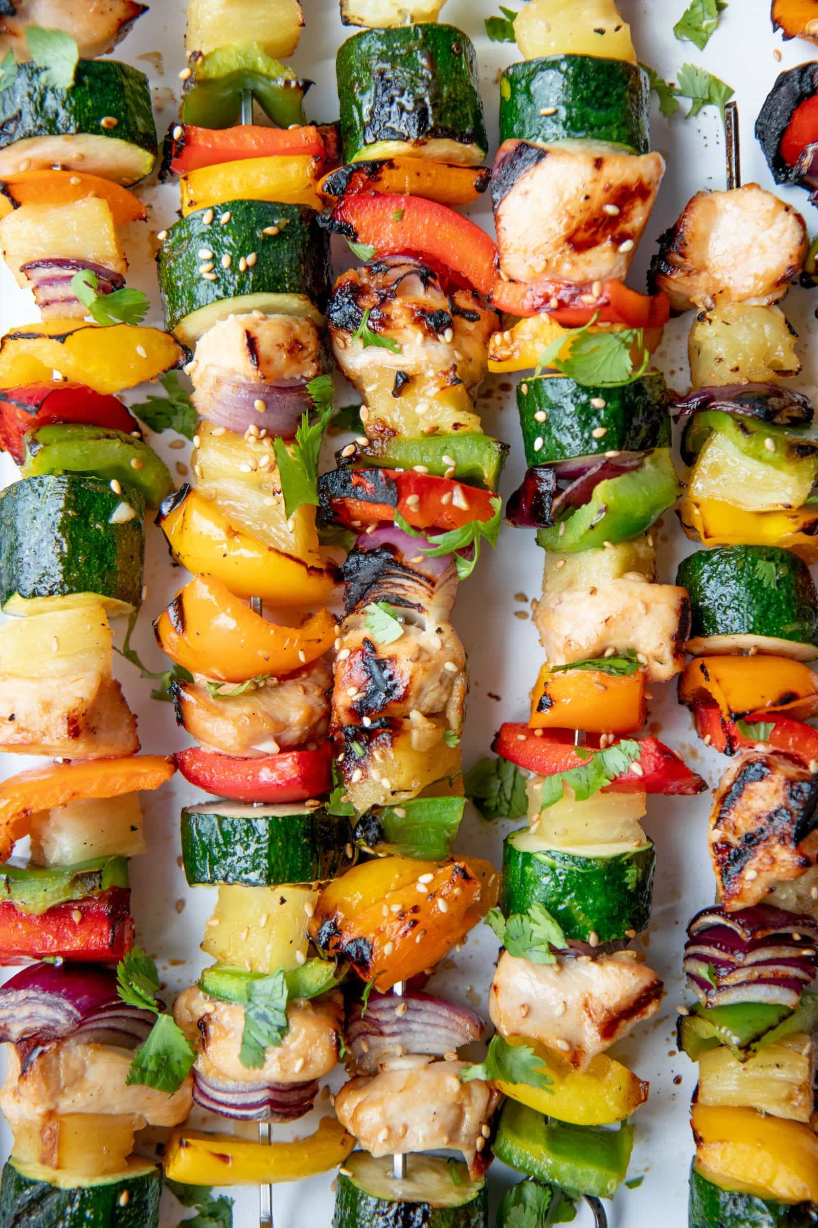 Finished Grilled Hawaiian Chicken Kabobs on a white background