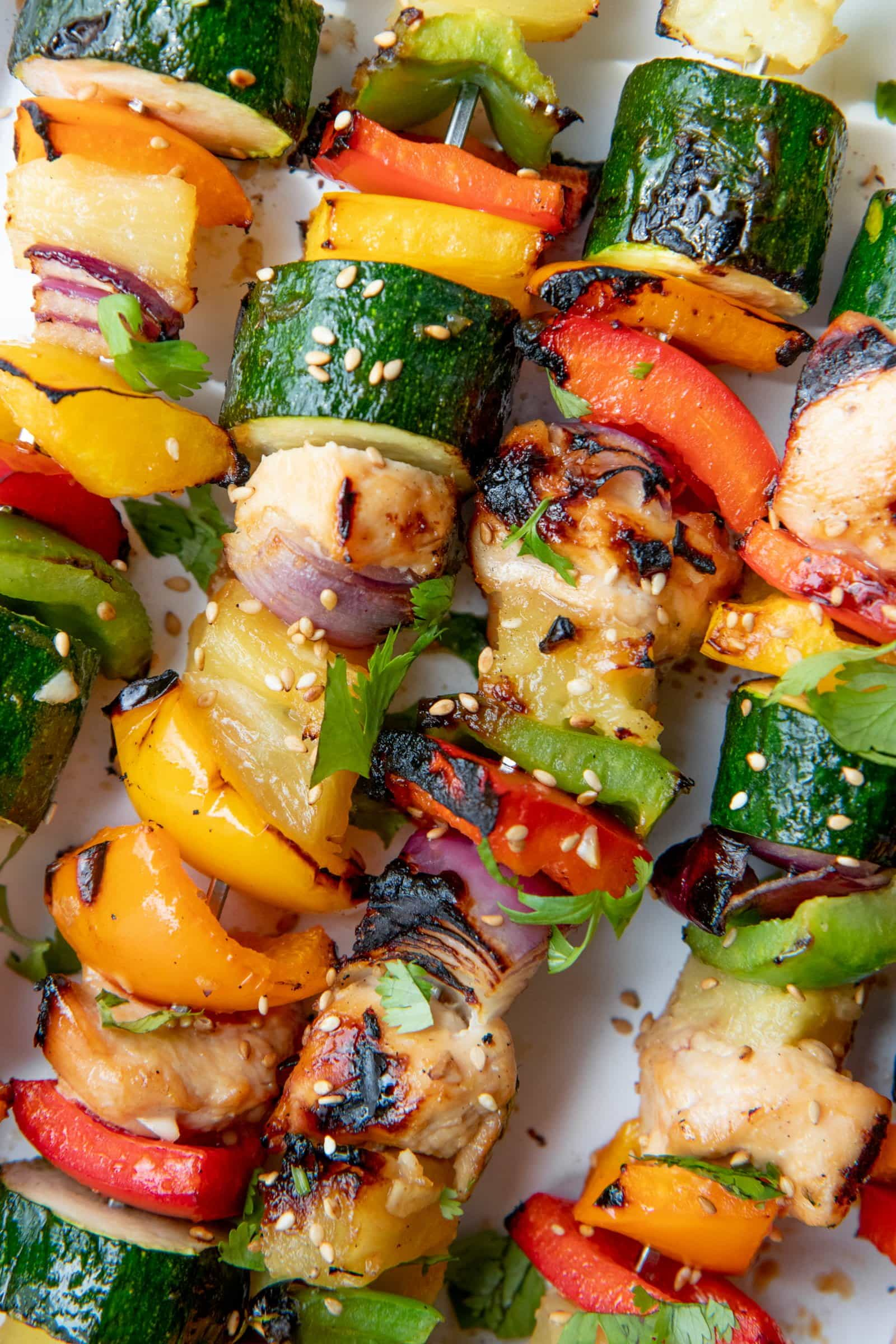 Close up of Grilled Chicken Kabobs on a white background