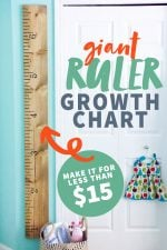 """DIY Giant Growth Chart Ruler hanging on a turquoise wall next to a white door. A text overlay reads """"Giant Ruler Growth Chart. Make It For Less Than $15."""""""