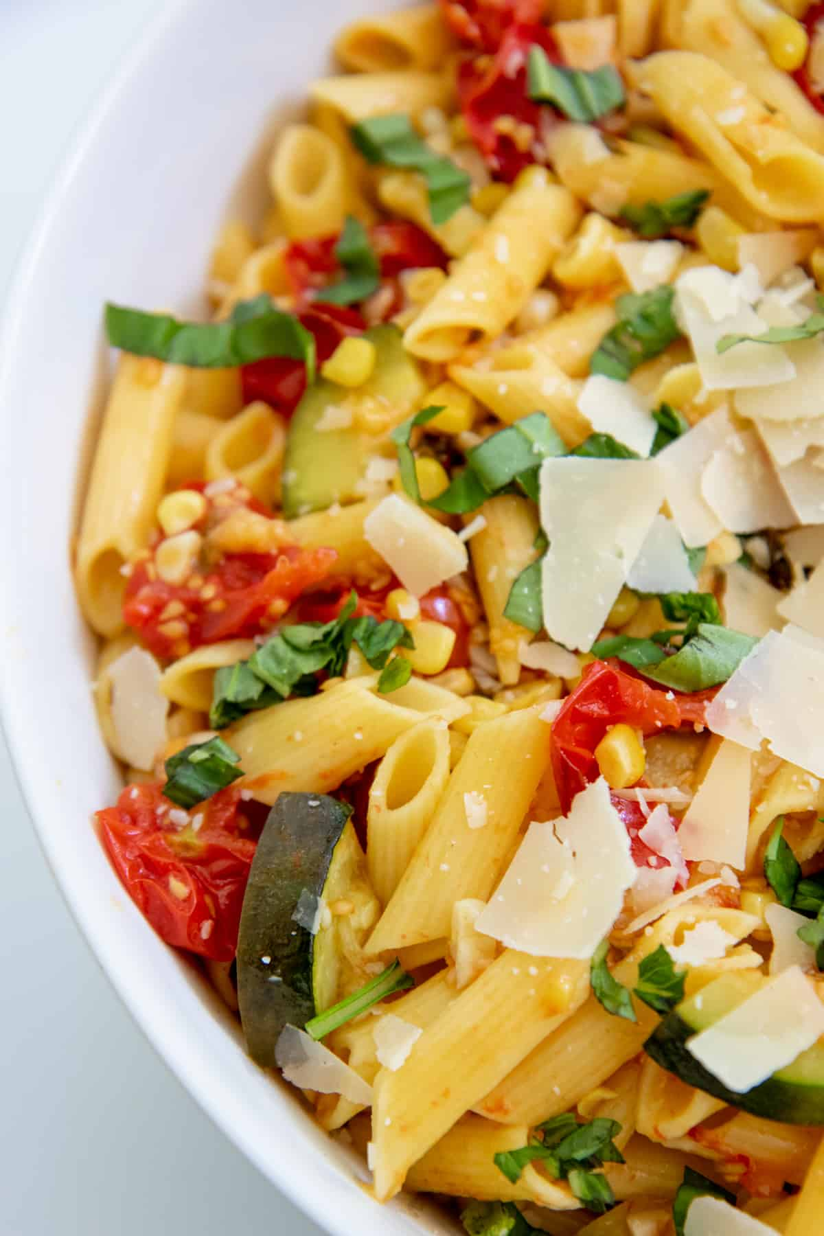 Close up of Summer Roasted Vegetable Pasta in a white bowl