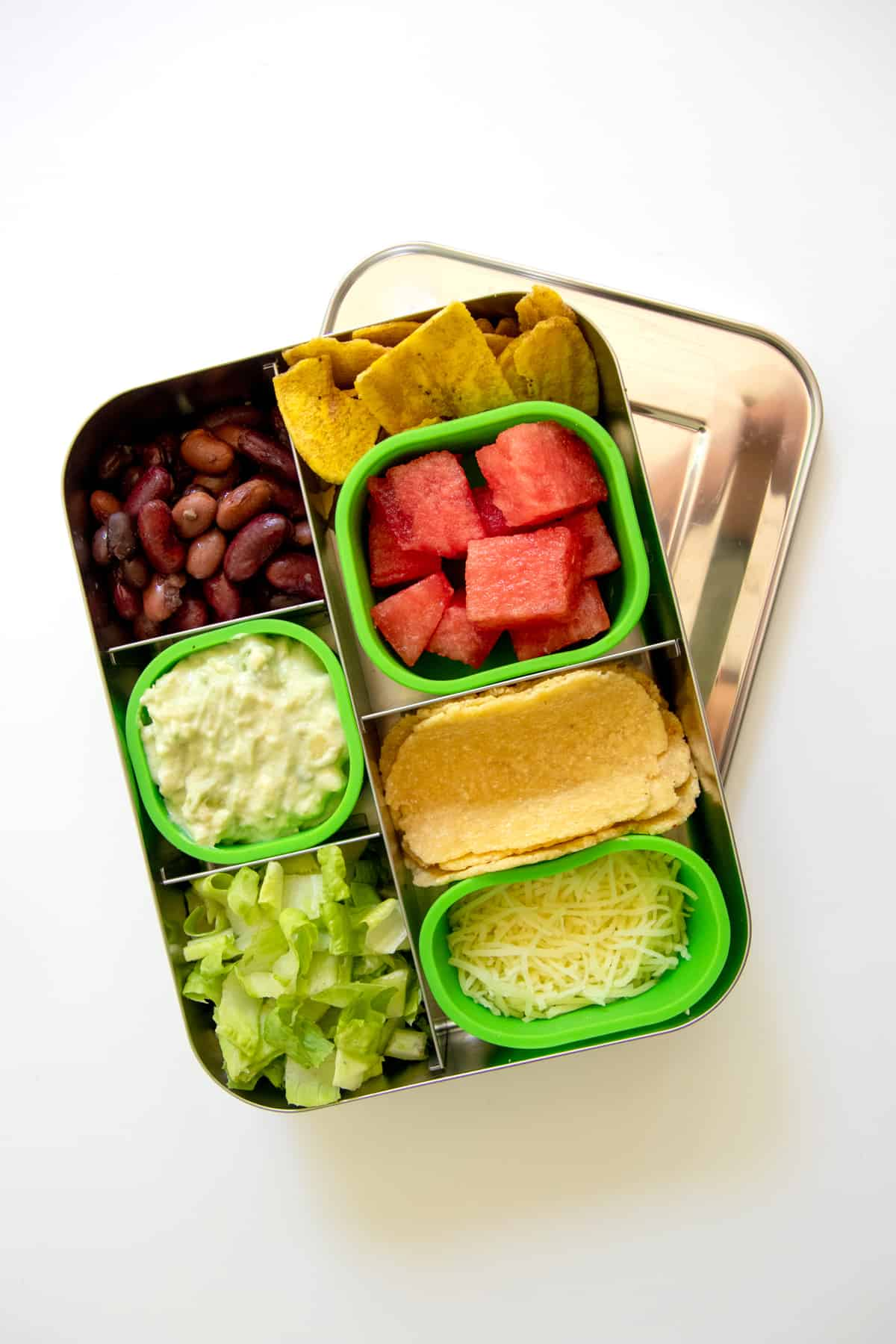 Bento-style lunch box filled with the makings for two-bite tacos