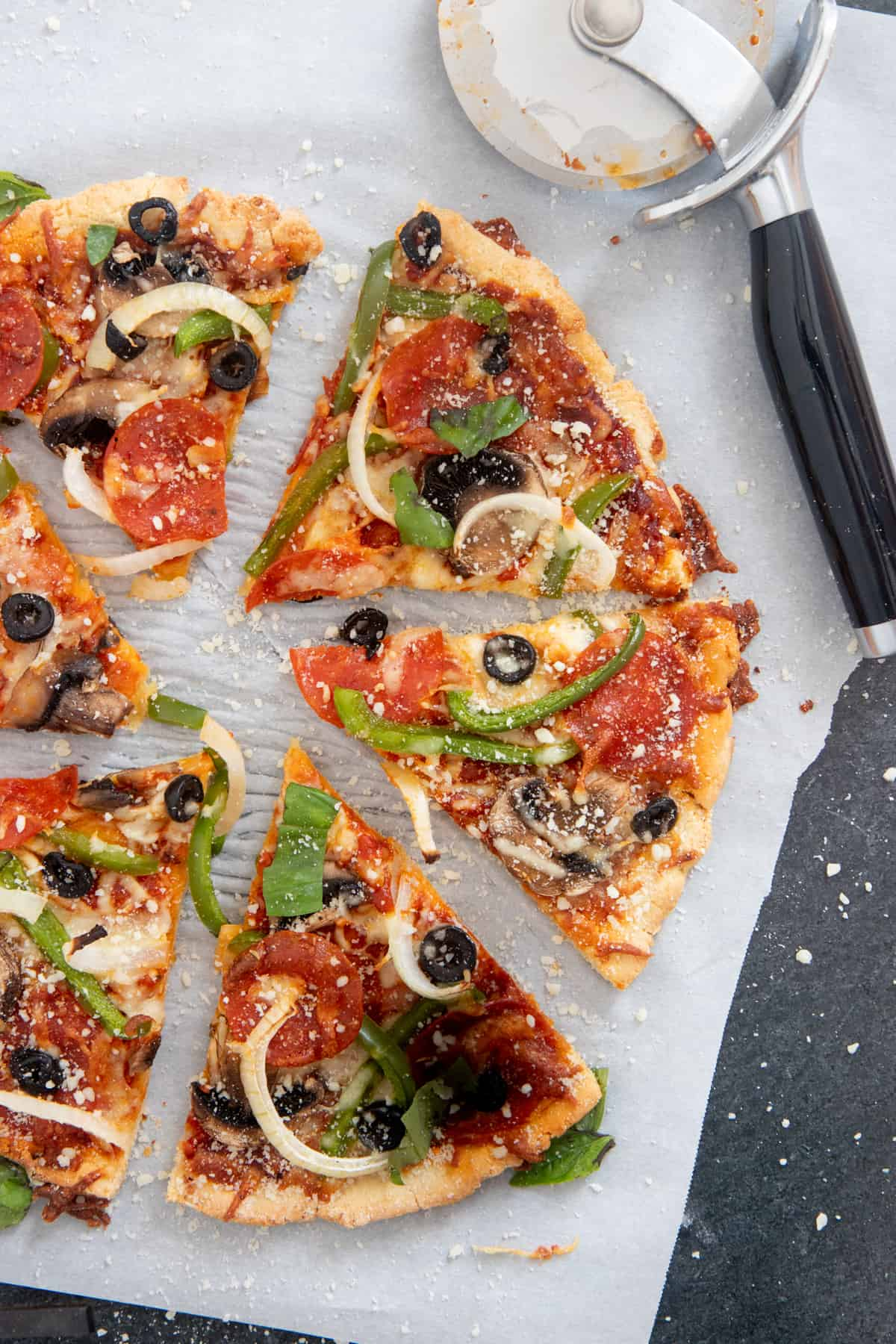 Sliced veggie pizza on an almond flour pizza crust.