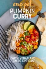 """Black dish of one pot pumpkin curry and rice noodles next to a halved pumpkin. A text overlay reads """"One Pot Pumpkin Curry with Vegan and Paleo Options."""""""